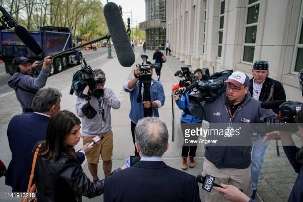 Paul DerOhannesian an attorney representing alleged sex cult leader Keith Raniere is surrounded by reporters and videographers as he arrives at the...