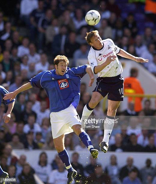 Paul Devlin of Birmingham City battles in the air with Teddy Sheringham of Tottenham Hotspur during the Barclaycard Premiership match between...