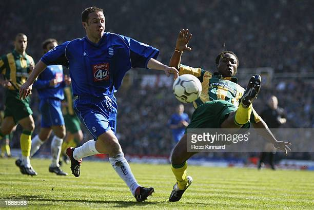Paul Devlin of Birmingham City is challenged by Ifeani Udeze of West Bromwich Albion during the FA Barclaycard Premiership match between Birmingham...