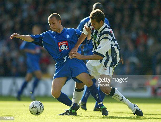 Paul Devlin of Birmingham City is challenged by Lee Marshall of West Bromwich Albion during the FA Barclaycard Premiership match between West...