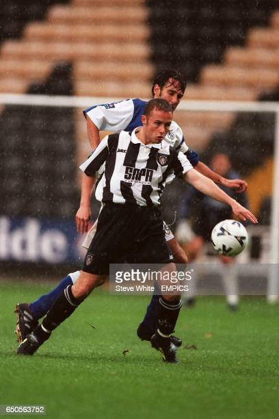 Paul Devlin of Notts County holds the ball up under pressure from Mark Smith of Bristol Rovers