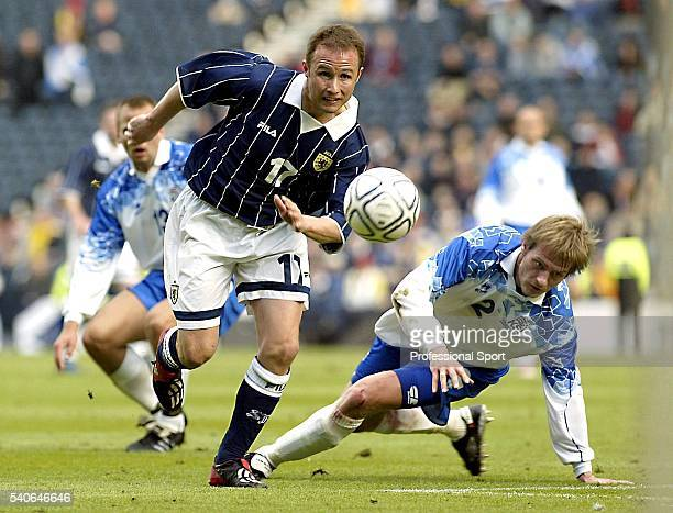 Paul Devlin of Scotland beats Bjarni Thorsteinsson of Iceland during the European Championships 2004 Group 5 Qualifying match between Scotland and...