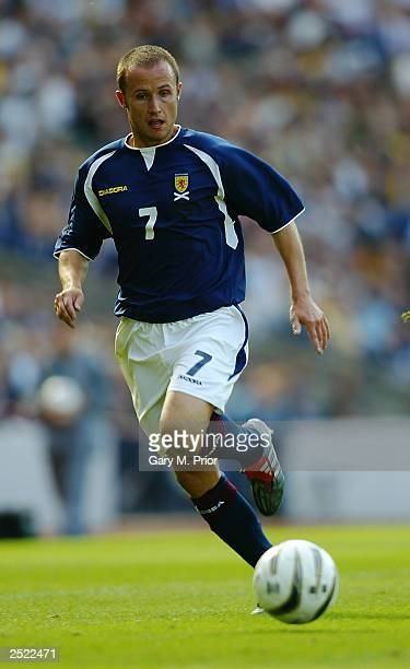 Paul Devlin of Scotland makes a break forward during the European Championships 2004 Group 5 Qualifying match between Scotland and the Faroe Islands...