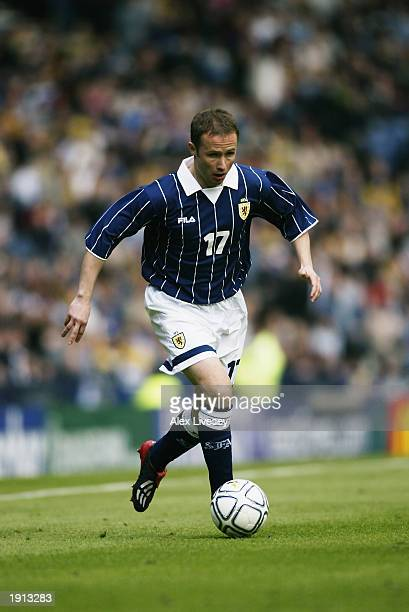 Paul Devlin of Scotland runs with the ball during the European Championships 2004 Group 5 Qualifying match between Scotland and Iceland held on March...
