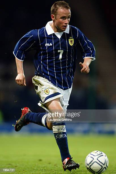 Paul Devlin of Scotland runs with the ball during the International Friendly match between Scotland and Austria held on April 30 2003 at Hampden Park...