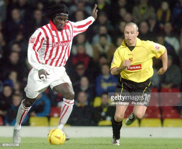 Paul Devlin of Watford battles with Ade Akinbiyi of Stoke City during the CocaCola Championship match at the Vicarage Road Watford Saturday December...