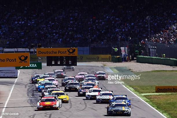 Paul di Resta of Great Britain and Mercedes team HWA leads the field after the start of race 2 of the DTM German Touring Car Hockenheim at...