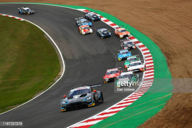 Paul di Resta of Great Britain and R-Motorsport drives an Aston Martin Vantage DTM as he leads the field during the DTM Race 1 at Brands Hatch on...