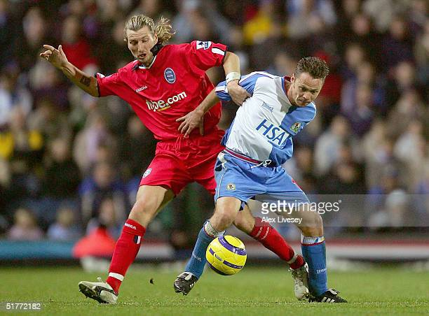 Paul Dickov of Blackburn Rovers holds off a challenge from Robbie Savage of Birmingham City during the Barclays Premiership match between Blackburn...