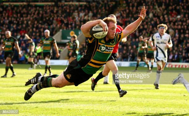 Paul Diggin of Northampton Saints dives over to score a try during the Guinness Premiership match between Northampton Saints and Sale Sharks at...