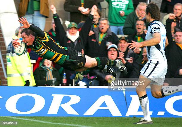 Paul Diggin of Northampton Saints scores the first try of the game during the European Challenge Cup match between Northampton Saints and Bristol...