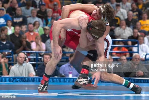 21 MARCH 2009 Paul Donahoe of Edinboro University wrestles with Troy Nickerson of Cornell University during their 125 pound championship match at the...