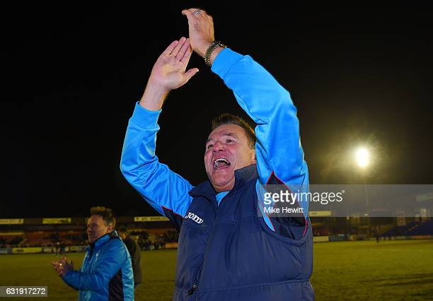 Paul Doswell Manager of Sutton United celebrates victory after the Emirates FA Cup third round replay between AFC Wimbledon and Sutton United at The...