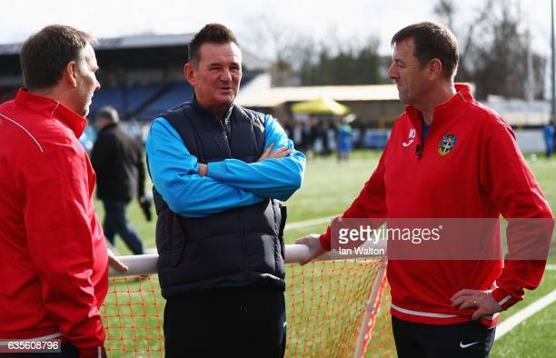 Paul Doswell manager of Sutton United exArsenal player and pundit Paul Merson and Matt Le Tissier in discussion during a Sutton United FA Cup media...