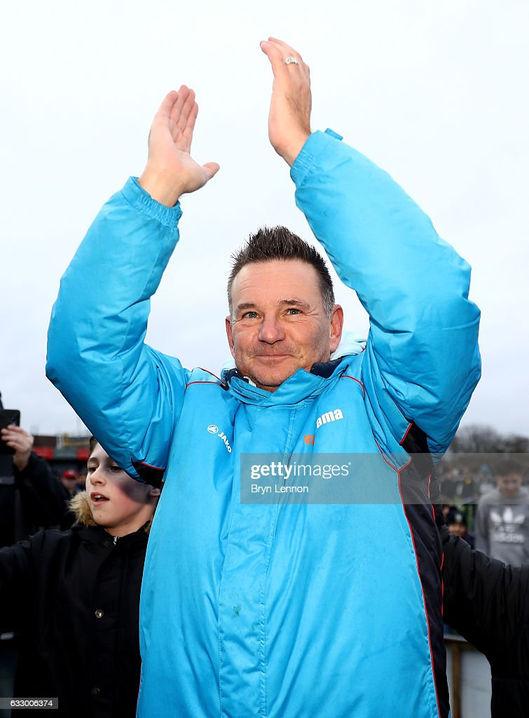 Paul Doswell, Manager of Sutton United shows appreciation to the fans after The Emirates FA Cup Fourth Round match between Sutton United and Leeds United at Borough Sports Ground on January 29, 2017 in Sutton, Greater London.