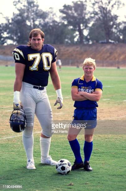 Paul Dougherty one of the smallest professional soccer players in the World posses with large San Diego Chargers NFL players Dougherty is an English...