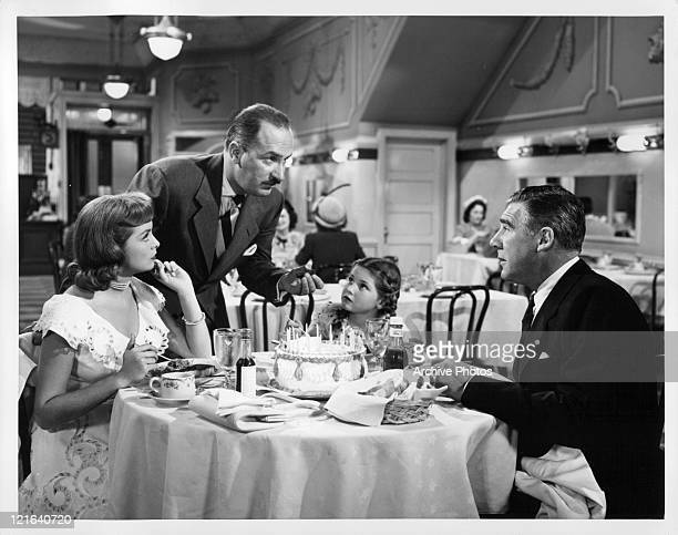 Paul Douglas resents the intrusion of Keenan Wynn at his birthday party while Janet Leigh and Donna Corcoran look on inquisitively in a scene from...