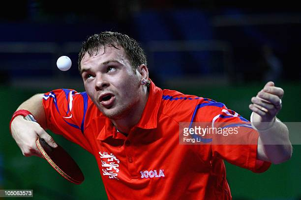 Paul Drinkhall of England competes in the Men's Team Semifinal at Yamuna Sports Complex during day five of the Delhi 2010 Commonwealth Games on...
