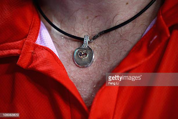 Paul Drinkhall of England wears a necklace of table tennis bat in the Men's Team Semifinal at Yamuna Sports Complex during day five of the Delhi 2010...