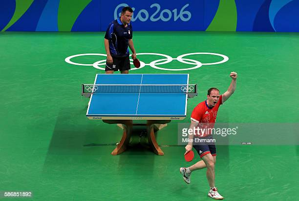 Paul Drinkhall of Great Britain celebrates winning a Men's Singles first round match against Aleksandar Karakasevic of Serbia on Day 1 of the Rio...