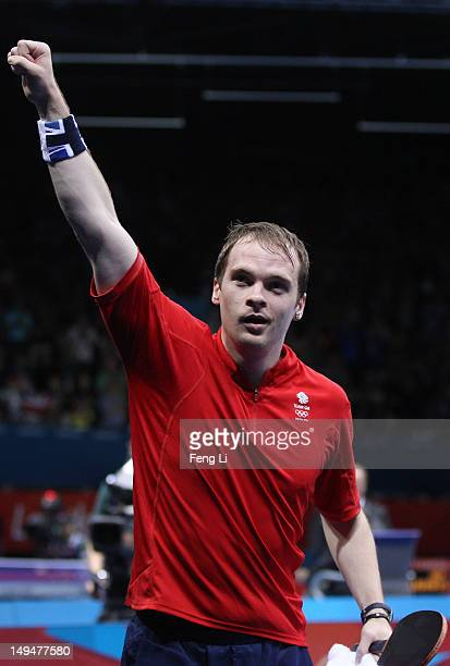 Paul Drinkhall of Great Britain celebrates winning his Men's Singles second round match against Zi Yang of Singapore on Day 2 of the London 2012...