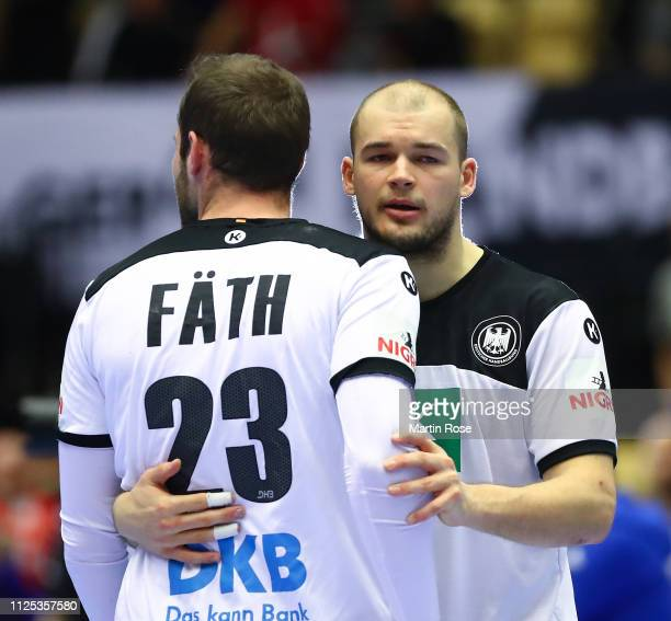 Paul Drux and Steffen Fath of Germany look dejected at the end during the 26th IHF Men's World Championship 3rd place match between Germany and...