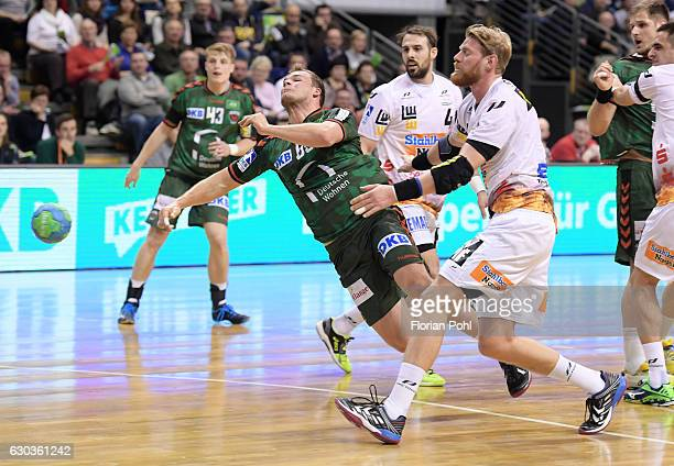 Paul Drux of Fuechse Berlin and Manuel Spaeth of Frisch Auf Goeppingen during the game between Fuechse Berlin and Frisch Auf Goeppingen on December...