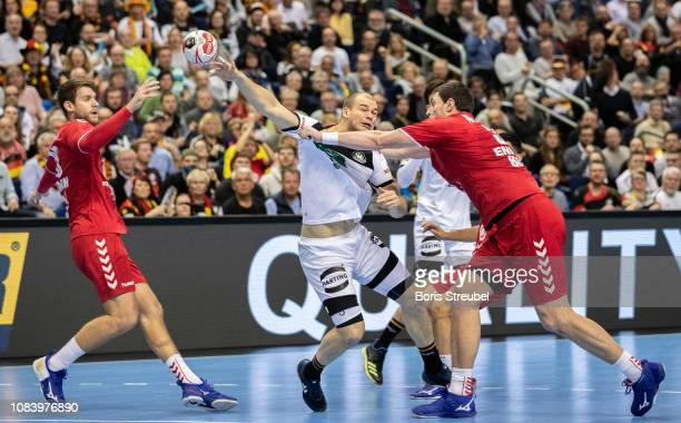 Paul Drux of Germany in action with Mijajlo Marsenic of Serbia during the 26th IHF Men's World Championship group A match between Germany and Serbia...