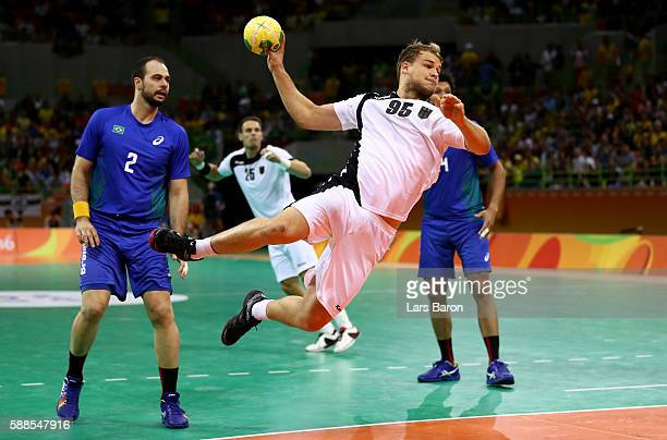 Paul Drux of Germany is challenged by Henrique Teixeira of Brazil during the Mens Preliminary Group B match between Brazil and Germany at Future...
