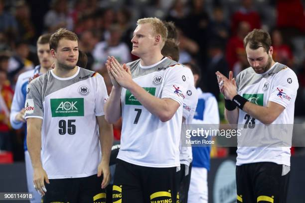 Paul Drux of Germany Patrick Wieneck of Germany and Steffen Fath of Germany react after the Men's Handball European Championship Group C match...