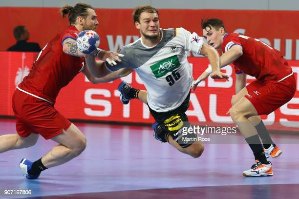 Paul Drux of Germany scores a goal against Pavel Horak of Czech Republic during the Men's Handball European Championship main round group 2 match...
