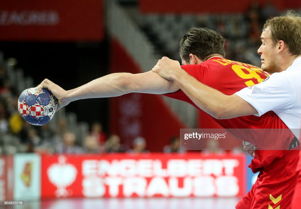 Paul Drux of Germany (R) vies for a ball with Vladan Lipovina of Montenegro during the preliminary round group C match of the Men's 2018 EHF European Handball Championship between Germany and Montenegro in Zagreb on January 13, 2018. /