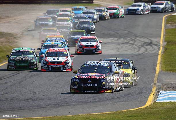 Paul Dumberell driving the Red Bull Racing Australia Holden leads at tha start of the Sandown 500 which is race 29 of the V8 Supercar Championship...