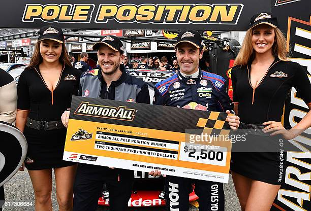 Paul Dumbrell and Jamie Whincup driver of the Red Bull Racing Australia Holden Commodore VF celebrates after taking pole position after the top ten...
