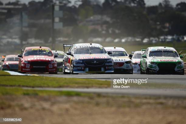 Paul Dumbrell leads into turn 1 in the Red Bull Holden Racing Team Holden Commodore ZB during race 24 for Supercars Sandown 500 at Sandown...