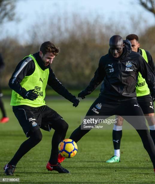 Paul Dummett and Mohamed Diame jostle for the ball during the Newcastle United Training session at the Newcastle Untied Training Centre on November 9...