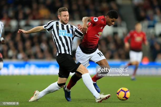 Paul Dummett of Newcastle battles with Marcus Rashford of Man Utd during the Premier League match between Newcastle United and Manchester United at...