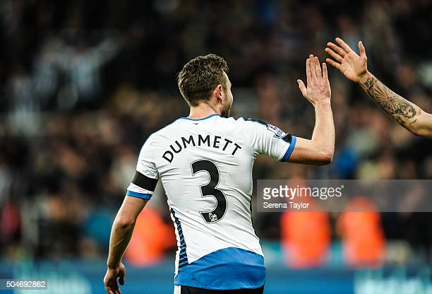 Paul Dummett of Newcastle celebrates with a high 5 after scoring Newcastle's third and equalising goal during the Barclays Premier League match...