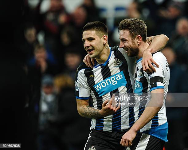 Paul Dummett of Newcastle celebrates with teammate Aleksandar Mitrovic after scoring Newcastle's third and equalising goal during the Barclays...