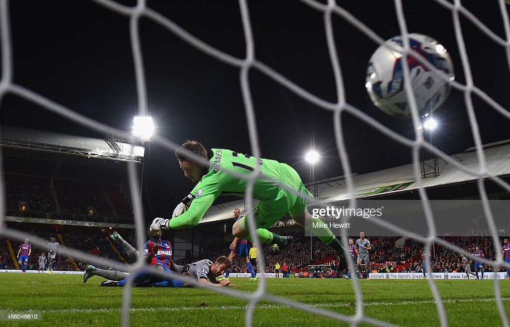 Paul Dummett of Newcastle heads his team's winning goal past Wayne Hennessey of Crystal Palace during the Capital One Cup Third Round match between Crystal Palace and Newcastle United at Selhurst Park on September 24, 2014 in London, England.