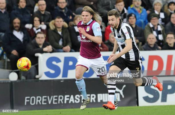 Paul Dummett of Newcastle is chased down by Birkir Bjarnason of Villa during the Sky Bet Championship match between Newcastle United and Aston Villa...