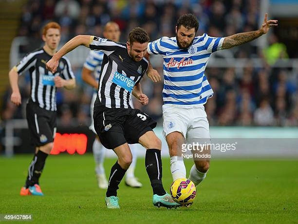 Paul Dummett of Newcastle United and Charlie Austin of QPR battle for the ball during the Barclays Premier League match between Newcastle United and...