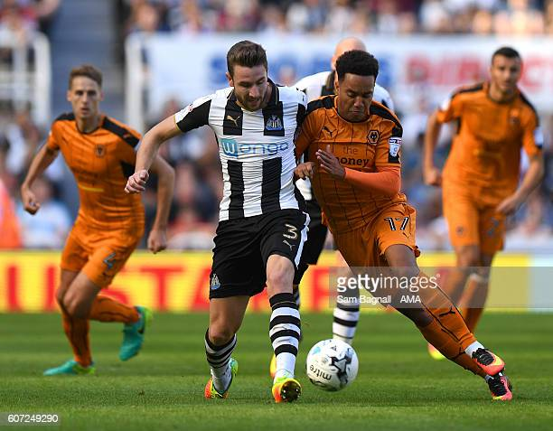 Paul Dummett of Newcastle United and Helder Costa of Wolverhampton Wanderers during the Sky Bet Championship match between Newcastle United v...