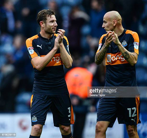 Paul Dummett of Newcastle United and Jonjo Shelvey applaud the fans after winning the Sky Bet Championship Match between Preston North End and...
