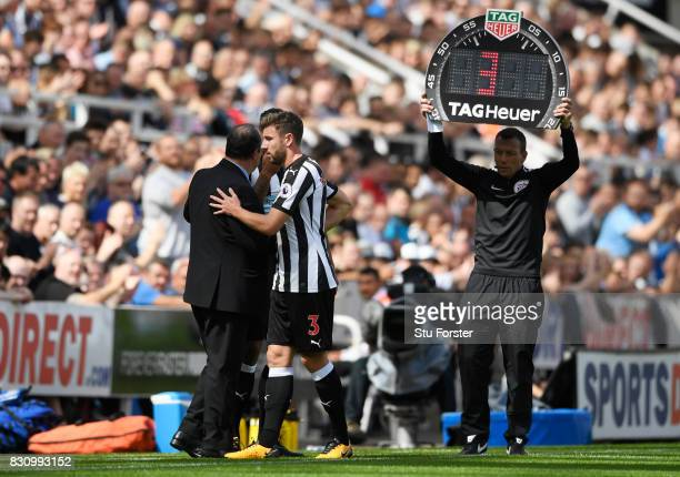 Paul Dummett of Newcastle United and Rafael Benitez Manager of Newcastle United embrace after he is subbed off through injury during the Premier...