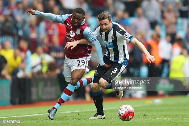 Paul Dummett of Newcastle United and Rushian HepburnMurphy of Aston Villa compete for the ball during the Barclays Premier League match between Aston...