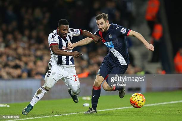 Paul Dummett of Newcastle United and Stephane Sessegnon of West Bromwich Albion compete for the ball during the Barclays Premier League match between...