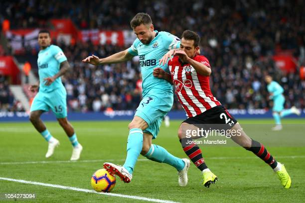 Paul Dummett of Newcastle United battles for possession with Cedric Soares of Southampton during the Premier League match between Southampton FC and...