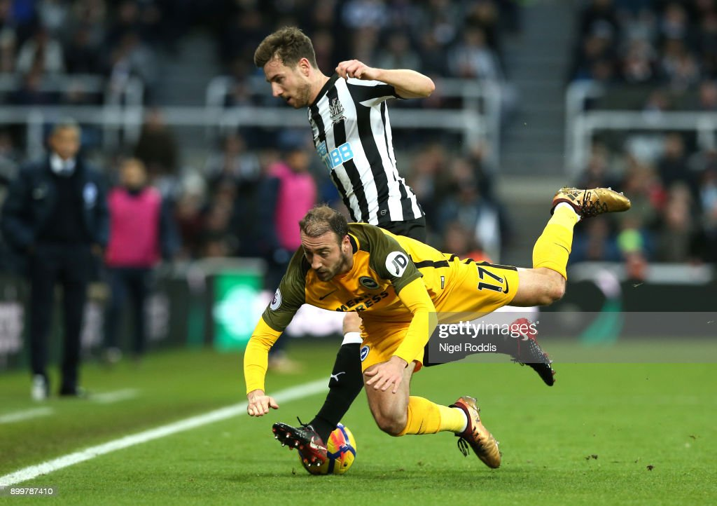Paul Dummett of Newcastle United challenges Glenn Murray of Brighton and Hove Albion during the Premier League match between Newcastle United and Brighton and Hove Albion at St. James' Park on December 30, 2017 in Newcastle upon Tyne, England.