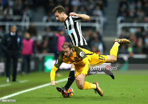 Paul Dummett of Newcastle United challenges Glenn Murray of Brighton and Hove Albion during the Premier League match between Newcastle United and...